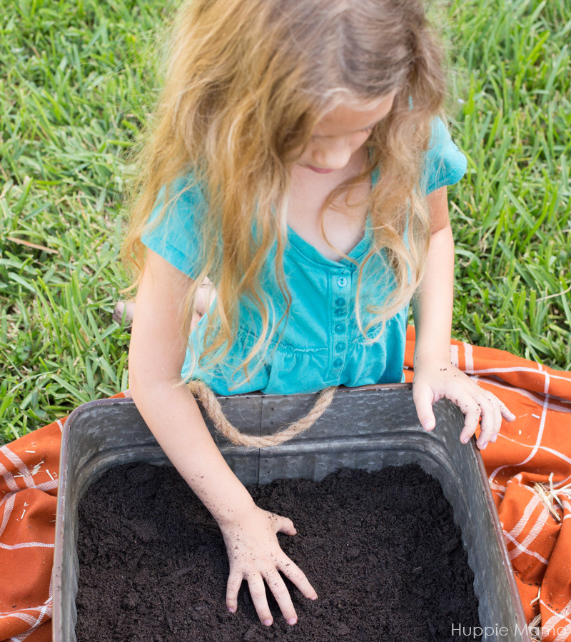 girl digs soil