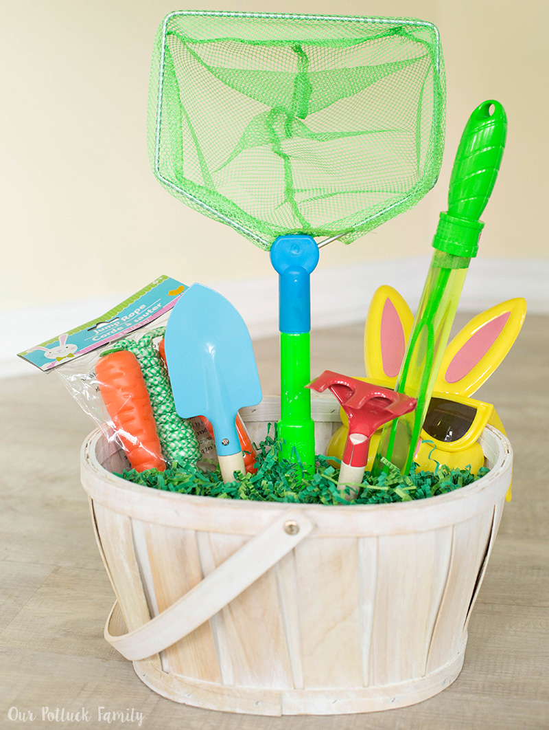 Easter basket for active boys our potluck family i added all of the larger pieces to the basket this includes an easter themed jumprope for active play bubble wand small shovel and rake small net for negle Choice Image