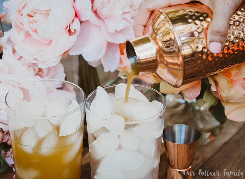 Peach Mango Sparkling Rosé Cocktail pour